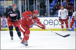 Detroit's Henrik Zetterberg takes a shot during a team practice in preparation for Saturday's season opener.