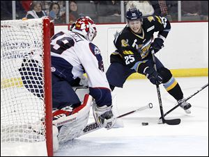 The Walleye's Ben Youds looks to shoot on Kalamazoo goaltender Joel Martin. Youds is one of several players who have been on the move since the end of the NHL lockout. The Red Wings sent him to Rockford of the AHL. Five Walleye players were sent to the AHL.
