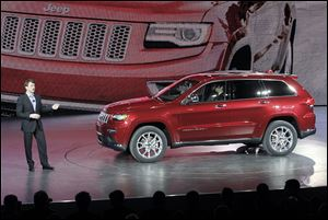 Jeep President and CEO Mike Manley speaks about the 2014 diesel Jeep Grand Cherokee at the North American International Auto Show in Detroit.