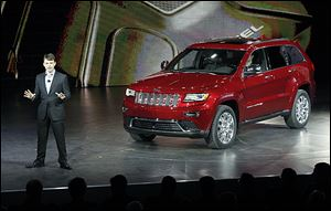 Jeep CEO Mike Manley unveils the 2014 Jeep Grand Cherokee equiped with a diesel engine at the North American International Auto Show in Detroit.