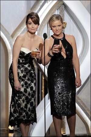 Tina Fey, left, and Amy Poehler got thumbs up on Twitter as hosts of this year's Golden Globes.