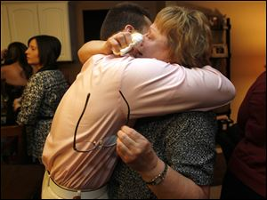 Rick Gonzales, left, hugs his aunt Melody Gonzales, right, who is Josie Langsdorf's mother while Scott Disick, visits.