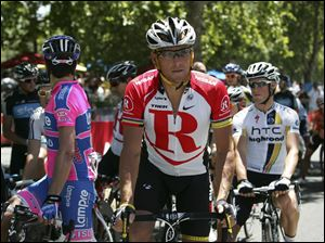 "Lance Armstrong, center, was stripped of his Tour de France titles, lost most of his endorsements and was forced to leave Livestrong last year after the U.S. Anti-Doping Agency issued a damning, 1,000-page report that accused him of masterminding a long-running doping scheme. Monday he spoke to the Livestrong staff, saying, ""I'm sorry."""