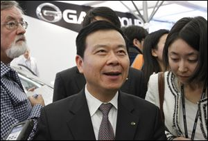 Wang Xia, president of the Guangzhou Automobile Group, speaks with members of the media about future Jeep production.
