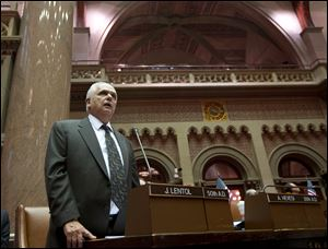 Assemblyman Joseph Lentol, D-Brooklyn, explains his vote for New York's Secure Ammunition and Firearms Enforcement Act in the Assembly Chamber at the Capitol in Albany, N.Y.