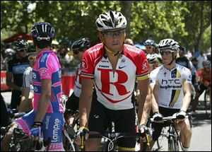Lance Armstrong, center, was stripped of his Tour de France titles, lost most of his endorsements and was forced to leave Livestrong last year after the U.S. Anti-Doping Agency issued a damning, 1,000-page report that accused him of masterminding a long-running doping scheme. Monday he spoke to the Livestrong staff, saying,