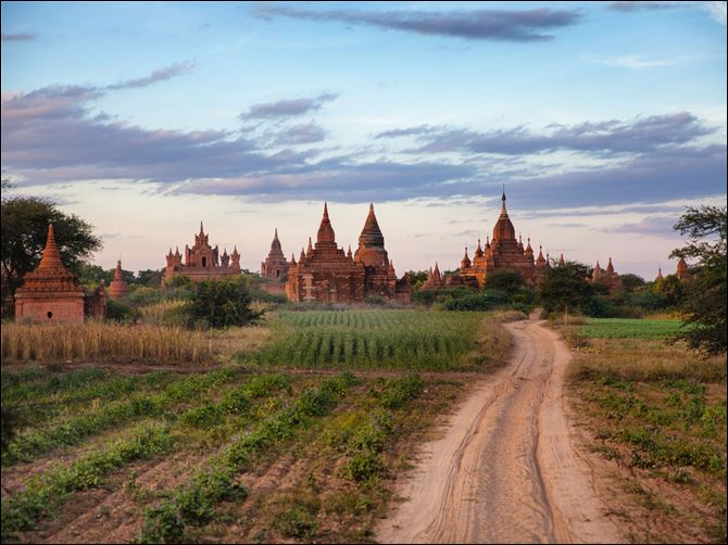 Travel Trip Myanmar The sun sets over some of the pagodas in Bagan, Myanmar.