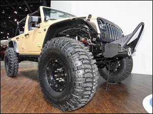 Massive tires outfit the Mopar Customized Jeep Wrangler Sand Trooper.
