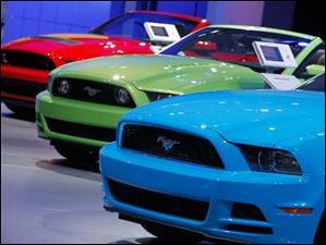 Ford Mustangs in a colorful array.