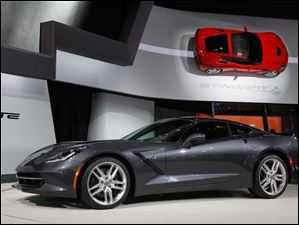 A pair of new Corvette Stingrays sit on display in Detroit.