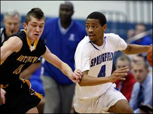 Springfield's Marquan Hodges (4) steals  the ball from Sylvania Northview's Jeff Czerniakowski (10).