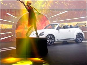 A dancer entertains at the Volkswagen display.