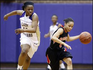 Rogers' Keyanna Austin steals the ball from Waite's Ramiah Henry.