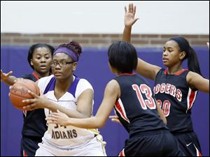 Waite's Latesha Craig looks for an opening against Rogers' Sasha Dailey (1), Akienreh Johnson (30), and Toriana Easley (13).