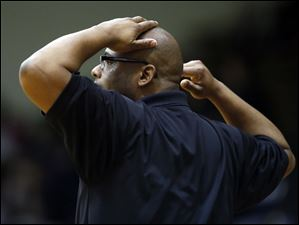 Waite head coach Manny May reacts to the action against Rogers.