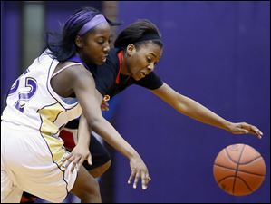 Rogers' Sasha Dailey steals the ball from Waite's Yatiah Caldwell (32).
