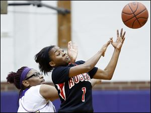 Rogers' Sasha Dailey (1) steals the ball from Waite's Latesha Craig.