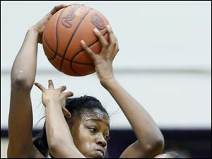 Rogers' Sasha Dailey (1) defends against  Waite's Kre'Ana Henry (20).