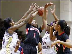 Rogers' Sasha Dailey takes a shot against Waite's Latesha Craig (54).