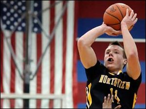 Sylvania Northview's Conner Hartnett (14) takes a shot against Springfield's Ty Shy (24).