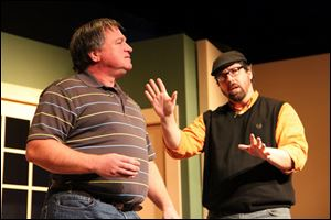 "From left, Lane Hakel and Heath Huber in a scene from ""Fox on the Fairway,"" a Toledo Rep production."