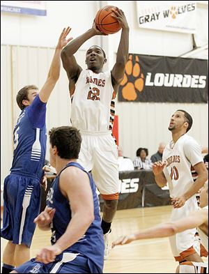 Lourdes' Elvin Butler shoots over Lawrence Tech's Thomas Hoff  during their  game Wednesday at Tam-O-Shanter. Butler had 18 points in the win.