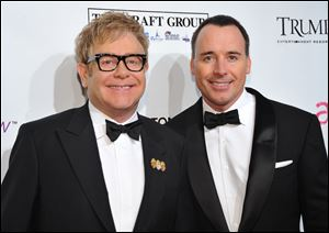 Sir Elton John, left, and David Furnish
