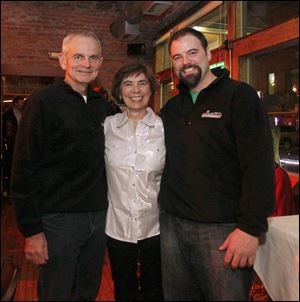 Owners Marty Lahey, left, Barbara Lahey, center, and Zach Lahey, right, celebrate 10th anniversary of their restaurant Manhattan's.