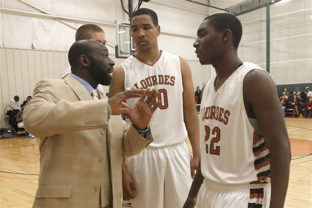 Lourdes-head-coach-Andre-Smith-instructs-players