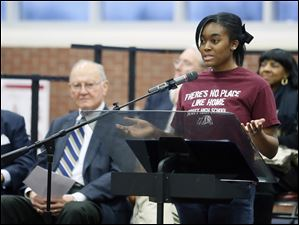 Scott High School student Akia Williams, 17, speaks during a program celebrating the school's 100th anniversary.