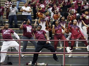 The Scott High School pep band performs during a program celebrating the school's 100th anniversary.
