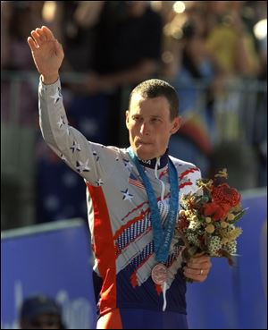 U.S. cyclist Lance Armstrong waves after receiving the bronze medal in the men's individual time trials at the 2000 Summer Olympics cycling road course in Sydney, Australia.