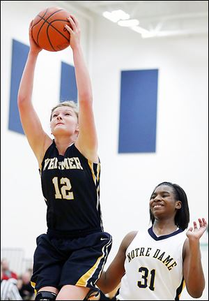 Whitmer's Samantha Meinen pulls down in a rebound in front of Notre Dame's Tierra Floyd. The Eagles stayed perfect in the TRAC with the win.