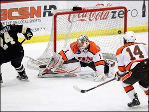 Western Michigan's Shane Berschbach (24) shoots over BGSU goalie Andrew Hammond during the first period.  The Broncos' Chase Balisy (13) made the rebound for the score.