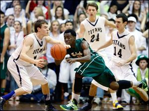 Central Catholic's C.J. Bussey (12) and  St. John's Jesuit's Austin Gardner (10) battle for the ball.