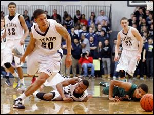 St. John's Jesuit's Tyler Thompson (20) chases a loose ball against Central Catholic.