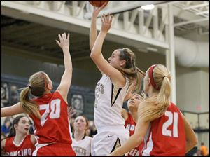Perrysburg's Allex Brown shoots over Bowling Green's Livvy Dill (20).