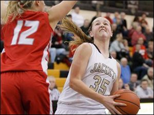 Perrysburg's Allex Brown drives against Bowling Green's Sara Morlock.