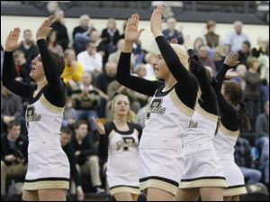 Perrysburg cheerleaders including Heather Hugg, front, center, cheer for the Yellow Jackets.