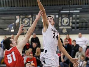 Perrysburg's Nick Moschetti lays one up over Bowling Green's Nolan Dill.