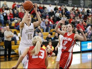 Perrysburg's Maddy Perry shoots over Bowling Green's Reagan Morman (23) during their girls basketball game.