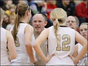 Perrysburg girls basketball coach Todd Sims instructs his players against Bowling Green.