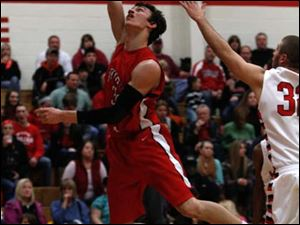 Bedford's Jackson Lamb goes in for a layup against Monroe.
