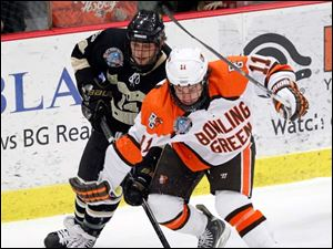 BGSU's Dan Desalvo (11) battles Western Michigan's Colton Hargrove (14) for the puck.
