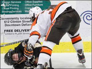 BGSU's Connor Kucera (3) knocks down Western Michigan University player Trevor Elias (21).