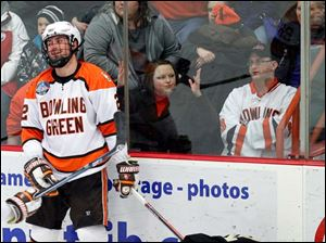 BGSU's Ryan Peltoma reacts after drawing a penalty against Western Michigan University player Trevor Elias (21) during the third period.