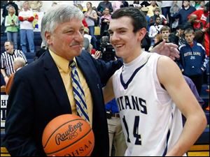 St. John's head coach coach Ed Heintschel earns his 600th career victory and the game ball which was presented to him by Chris Stearns (14).