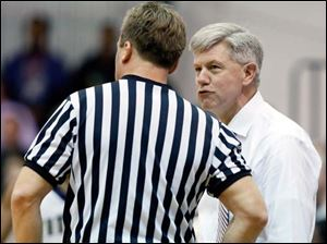 Central Catholic head coach Jim Welling argues a call with an official.