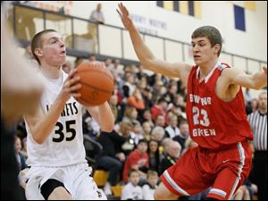 Perrysburg's Shane Edwards (35) looks for a shot while being guarded by Bowling Green's LaMonta' Stone (23).