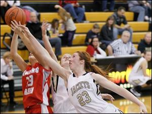 Bowling Green's Reagan Morman (23), left, and Perrysburg's Sarah Baer (23) fight for a rebound.
